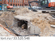 Uncovered underground tunnel for pipeline network in Spandauer Strasse in Berlin-Mitte, in the background the Red City Hall (2019 год). Редакционное фото, агентство Caro Photoagency / Фотобанк Лори