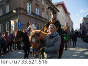 Купить «Poland, Poznan - Epiphany Day is officially celebrated at the Old Market Square. Amateur actors on horseback mime the Three Kings.», фото № 33521516, снято 6 января 2017 г. (c) Caro Photoagency / Фотобанк Лори
