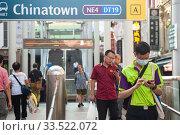 Купить «Singapore, Republic of Singapore, Passers-by with mouthguards in the Chinatown district», фото № 33522072, снято 28 февраля 2020 г. (c) Caro Photoagency / Фотобанк Лори