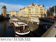 Купить «Prague, Czech Republic - October 13, 2019: Vltava river embankment on a sunny autumn day», фото № 33526532, снято 13 октября 2019 г. (c) Яков Филимонов / Фотобанк Лори