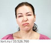 Безразличное, ленивое выражение лица у взрослой женщины. Стоковое фото, фотограф Кекяляйнен Андрей / Фотобанк Лори
