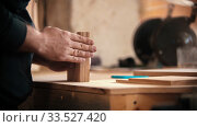 Купить «Carpentry industry - man holding flat pieces of wooden details in the workshop», фото № 33527420, снято 3 июля 2020 г. (c) Константин Шишкин / Фотобанк Лори