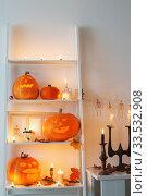 Купить «halloween pumpkins with candles on wooden table», фото № 33532908, снято 1 ноября 2019 г. (c) Майя Крученкова / Фотобанк Лори