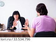 Купить «Young man consulting with judge on litigation issue», фото № 33534796, снято 6 мая 2019 г. (c) Elnur / Фотобанк Лори