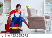 Купить «Super hero repairman working at home», фото № 33535572, снято 23 декабря 2016 г. (c) Elnur / Фотобанк Лори