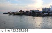 Aerial coastal sunset view of San Juan city harbor ferry terminal and cruise Port hotel and condominium resorts Puerto Rico Caribbean. Стоковое видео, видеограф Василий Кочетков / Фотобанк Лори