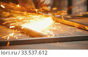 Купить «Man worker grinding the seams of an iron frame in the workshop - the sparkles», видеоролик № 33537612, снято 30 мая 2020 г. (c) Константин Шишкин / Фотобанк Лори