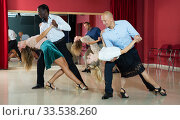 Купить «Couples enjoying latin dances», фото № 33538260, снято 4 октября 2018 г. (c) Яков Филимонов / Фотобанк Лори