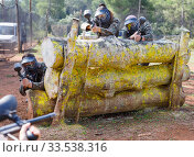 Купить «Portrait of team of adult people playing on paintball battlefield outdoor», фото № 33538316, снято 22 сентября 2018 г. (c) Яков Филимонов / Фотобанк Лори