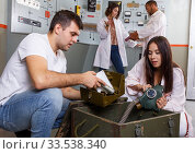 Young people with military box in lost room-bunker. Стоковое фото, фотограф Яков Филимонов / Фотобанк Лори