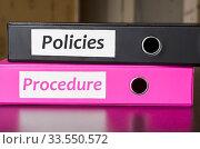 Купить «Bright office folders over dark background and policies and procedure text concept», фото № 33550572, снято 29 мая 2020 г. (c) easy Fotostock / Фотобанк Лори