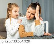 Купить «Small girl consoling unhappy young mother after conflict», фото № 33554928, снято 25 мая 2020 г. (c) Яков Филимонов / Фотобанк Лори