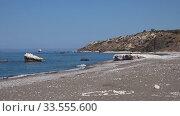 Купить «Petra tou Romiou or Aphrodite Rock Beach, one of the main attractions and landmarks of Cyprus island.», видеоролик № 33555600, снято 4 апреля 2020 г. (c) Serg Zastavkin / Фотобанк Лори