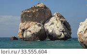 Купить «Aphrodite's Stone on Petra tou Romiou or Aphrodite Rock Beach, one of the main attractions and landmarks of Cyprus island.», видеоролик № 33555604, снято 5 апреля 2020 г. (c) Serg Zastavkin / Фотобанк Лори