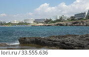 Zoom video of coastal plateau of Cape Greco with the Ayia Napa on the background. Cyprus. Стоковое видео, видеограф Serg Zastavkin / Фотобанк Лори