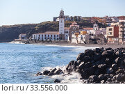 The Basilica of the Royal Marian Shrine of Our Lady of Candelaria with shoreline. The Candelaria town is a popular touristic place for visiting. Tenerife, Canary island, Spain (2016 год). Стоковое фото, фотограф Кекяляйнен Андрей / Фотобанк Лори