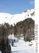 Купить «Beautiful mountains covered with snow. Sunny day and blue sky on a frosty day», фото № 33558532, снято 5 марта 2019 г. (c) Олег Хархан / Фотобанк Лори