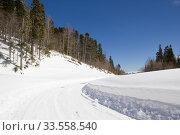 Купить «Beautiful mountains covered with snow. Sunny day and blue sky on a frosty day», фото № 33558540, снято 5 марта 2019 г. (c) Олег Хархан / Фотобанк Лори