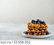 Купить «Healthy Gluten Free Oat Waffles. Copy Space», фото № 33558552, снято 8 апреля 2020 г. (c) Ольга Сергеева / Фотобанк Лори