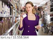 Купить «woman selecting hair care treatments», фото № 33558564, снято 24 февраля 2020 г. (c) Яков Филимонов / Фотобанк Лори