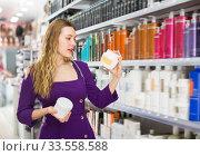 Stylish fine woman choosing hair care products. Стоковое фото, фотограф Яков Филимонов / Фотобанк Лори