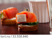Canape with salmon, young soft cheese, cucumber. Стоковое фото, фотограф Яков Филимонов / Фотобанк Лори