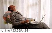Купить «Sleepy woman using laptop in morning», видеоролик № 33559424, снято 8 апреля 2020 г. (c) Ekaterina Demidova / Фотобанк Лори