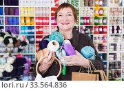 Купить «Woman with accessories for needlework», фото № 33564836, снято 10 мая 2017 г. (c) Яков Филимонов / Фотобанк Лори