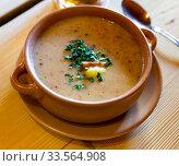 Купить «Zurek cream soup served with greens in bowl on table», фото № 33564908, снято 13 июля 2020 г. (c) Яков Филимонов / Фотобанк Лори