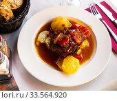 Купить «Tasty shoulder of lamb baked in oven with potatoes and stewed vegetables», фото № 33564920, снято 26 мая 2020 г. (c) Яков Филимонов / Фотобанк Лори