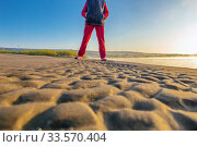 Купить «Legs of a woman on a sandy beach against the background of the rising sun. Autumn.», фото № 33570404, снято 7 сентября 2019 г. (c) Акиньшин Владимир / Фотобанк Лори