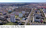Купить «Aerial view of modern residential areas of Polish city of Leszno in sunny spring day», видеоролик № 33570908, снято 14 марта 2020 г. (c) Яков Филимонов / Фотобанк Лори