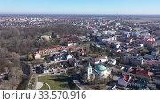 Купить «View from drone of Skierniewice cityscape on sunny spring day, Lodz Province, Poland», видеоролик № 33570916, снято 15 марта 2020 г. (c) Яков Филимонов / Фотобанк Лори