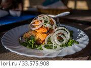 Купить «Fried kebab on plate and on a table», фото № 33575908, снято 20 февраля 2020 г. (c) Литвяк Игорь / Фотобанк Лори