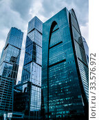 Moscow, Russia - September 24, 2016: Awesome modern glass skyscrapers in the Business centerBlue skyscraper facade. office buildings. modern glass silhouettes of skyscrapers. Редакционное фото, фотограф Андрей Зык / Фотобанк Лори