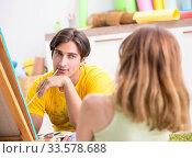 Купить «Young couple enjoying painting at home», фото № 33578688, снято 11 июля 2018 г. (c) Elnur / Фотобанк Лори
