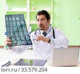 Купить «Doctor radiologist looking at x-ray scan in hospital», фото № 33579204, снято 14 мая 2018 г. (c) Elnur / Фотобанк Лори