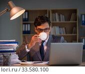 Купить «Businessman staying in the office for long hours», фото № 33580100, снято 18 октября 2016 г. (c) Elnur / Фотобанк Лори