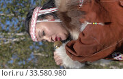 Vertical video woman sings song and dancing in traditional clothing of native people of Kamchatka Peninsula. Itelmens national ritual festival thanksgiving nature Alhalalalay (2019 год). Редакционное видео, видеограф А. А. Пирагис / Фотобанк Лори