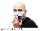 Bald head man wearing respiratory protective medical mask cough blood. Стоковое фото, фотограф Илья Андриянов / Фотобанк Лори