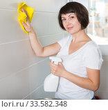 Купить «Woman washing tiles with rag», фото № 33582348, снято 22 ноября 2018 г. (c) Яков Филимонов / Фотобанк Лори