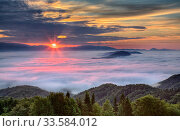 Купить «Sunrise with dawn over mist shrouded Ljubljana Basin, Grmada Hill, Tehovec, Slovenia, June 2008.», фото № 33584012, снято 16 июля 2020 г. (c) Nature Picture Library / Фотобанк Лори