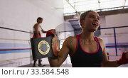 Купить «Mixed race woman happy to win in boxing gym», видеоролик № 33584548, снято 15 мая 2019 г. (c) Wavebreak Media / Фотобанк Лори