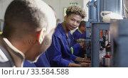 Купить «Group of mixed race men working in factory», видеоролик № 33584588, снято 23 мая 2019 г. (c) Wavebreak Media / Фотобанк Лори