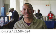 Купить «Front view of mixed race worker in factory», видеоролик № 33584624, снято 23 мая 2019 г. (c) Wavebreak Media / Фотобанк Лори