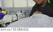 Купить «Mixed race woman using sewing machine in factory», видеоролик № 33584632, снято 23 мая 2019 г. (c) Wavebreak Media / Фотобанк Лори