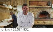 Купить «Caucasian chef looking at the camera», видеоролик № 33584832, снято 11 апреля 2019 г. (c) Wavebreak Media / Фотобанк Лори