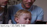 Купить «Close up view of baby looking at smartphone», видеоролик № 33585148, снято 12 апреля 2019 г. (c) Wavebreak Media / Фотобанк Лори