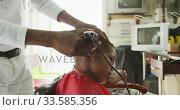 Купить «African man cutting African boy hair », видеоролик № 33585356, снято 19 сентября 2019 г. (c) Wavebreak Media / Фотобанк Лори