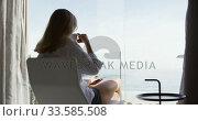 Caucasian woman drinking coffee in hotel. Стоковое видео, агентство Wavebreak Media / Фотобанк Лори